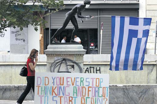 A statue in Athens 'joins' the protest against severe new austerity measures