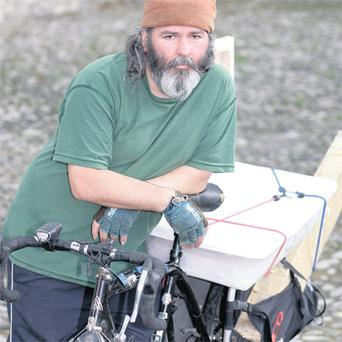 Easy rider: Artist Liam Daly has no trouble comfortably lugging his materials around the city, thanks to his innovative cargo bike