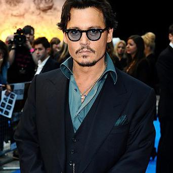 Warner Bros want to cast Johnny Depp as a magician