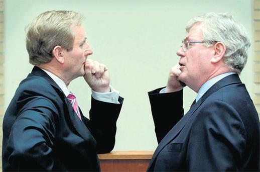 Taoiseach Enda Kenny with Tanaiste Eamon Gilmore at the launch yesterday of the visa-waiver scheme at the Department of Justice and Equality in Dublin