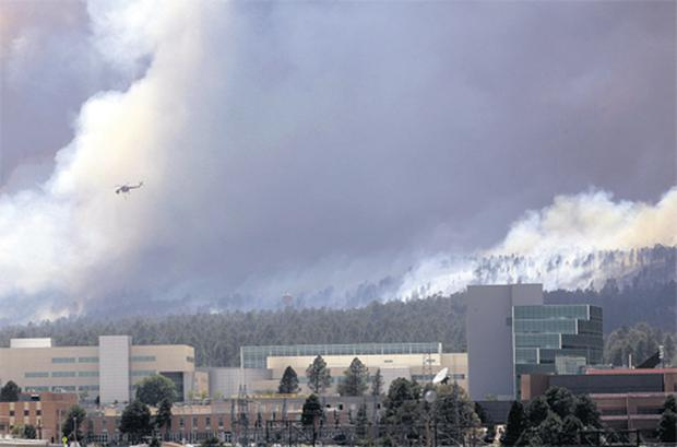 A helicopter over the fires near Los Alamos. US government scientists are sampling the air for contamination