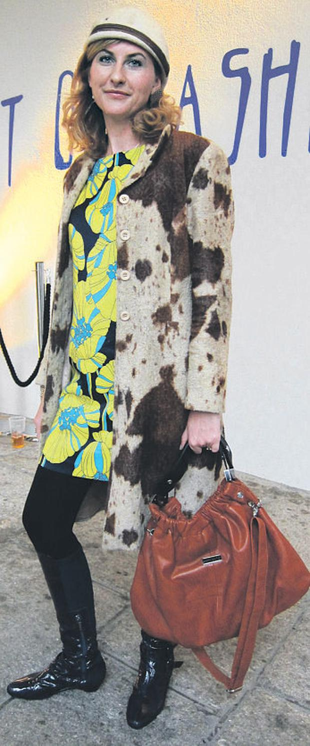 Aine's pony-print coat and chestnut bag add texture to her '60s-style shift.