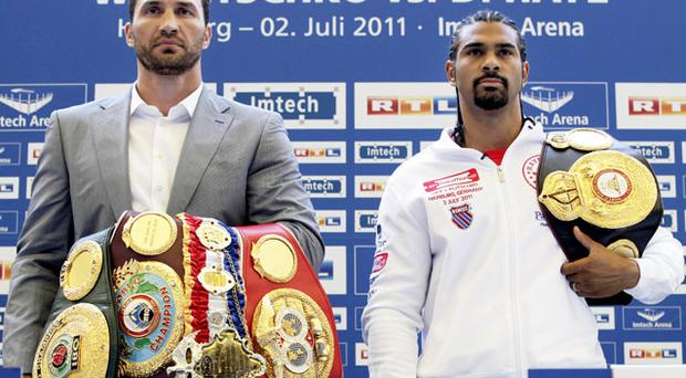 Wladamir Klitschko and David Haye pose at yesterday's weigh-in in Hamburg ahead of their heavyweight unification fight there tonight