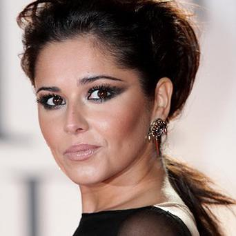 Cheryl Cole before swapping her long brunette locks for a new blonde hairstyle