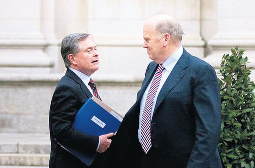 CONFIDENCE PUSH: Minister for Finance Michael Noonan, right, and Minister for Public Expenditure and Reform Brendan Howlin aim to encourage spending. Photo: David Conachy