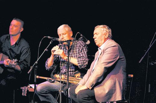 MELODIC VOICE: Louis O'Carroll, in the centre — and flanked by Neil Mitchell, far left, Tom Shanahan — has attracted a cult following after the release of his CD 'River to Sea' at a benefit concert in Listowel