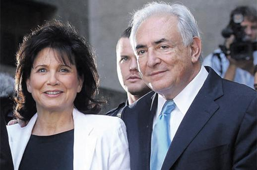 Dominique Strauss-Kahn and his wife Anne Sinclair leave the Friday hearing where he was freed on bail by the New York State Supreme Court