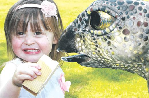 Jessie Becton (2) from Navan at the launch of the Erth Dinosaur Petting Zoo at Bewley's Hotel, Ballsbridge, Dublin, yesterday