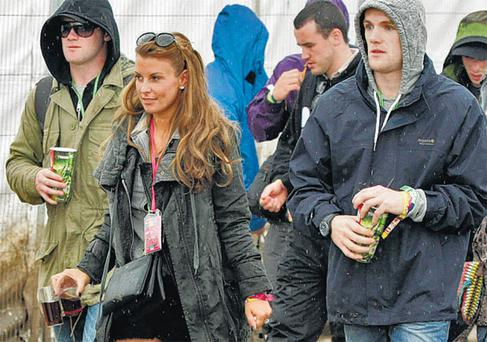 Wayne and Coleen Rooney with Wayne's brother John (right) backstage at the Glastonbury Festival