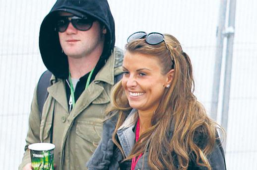 Wayne Rooney with his wife Coleen at the Glastonbury Festival