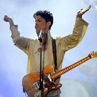 Prince performs on the main stage at the Hop Farm Festival