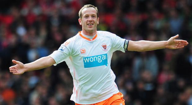 MANCHESTER, ENGLAND - MAY 22: Charlie Adam of Blackpool celebrates as scores their first goal from a free kick during the Barclays Premier League match between Manchester United and Blackpool at Old Trafford on May 22, 2011 in Manchester, England. (Photo by Shaun Botterill/Getty Images)