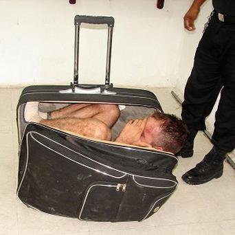 Mexican prison inmate Juan Ramirez Tijerina was caught trying to escape from jail while curled inside a suitcase (AP)