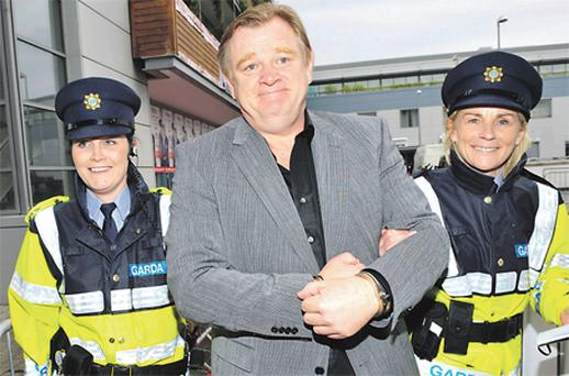 Garda Claire Burke and Sairsint Brid Ni Thuathail catch up with Brendan Gleeson at the Irish premiere of 'The Guard'