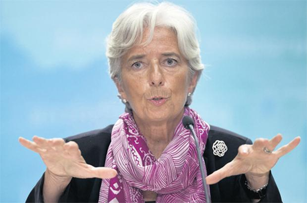 Newly appointed IMF chief Christine Lagarde speaking about her plans for leading the fund during her first news briefing at the IMF headquarters yesterday in Washington DC