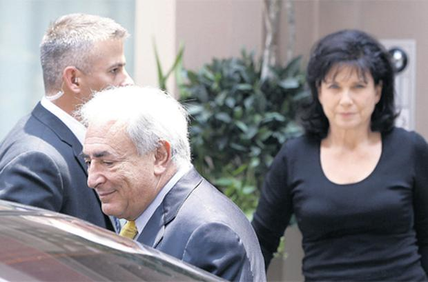 Former IMF chief Dominique Strauss-Kahn and his wife Anne Sinclair leaving their New York residence yesterday