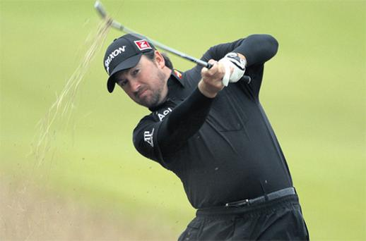 Graeme McDowell hits from the rough during a pro-am round ahead of the Scottish Open at Castle Stuart