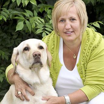 Formerly morbidly obese labrador Lucky with his owner and fellow slimmer Alyson King was named the PDSA's Pet Fit Club Champ