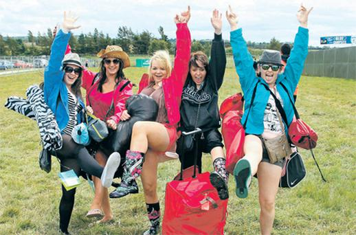Danielle Lynch, Tasha O'Toole, Billie Rose McCusker, Aoife Finnerty and Michelle Lynch, all from Cork, celebrate their arrival at Punchestown