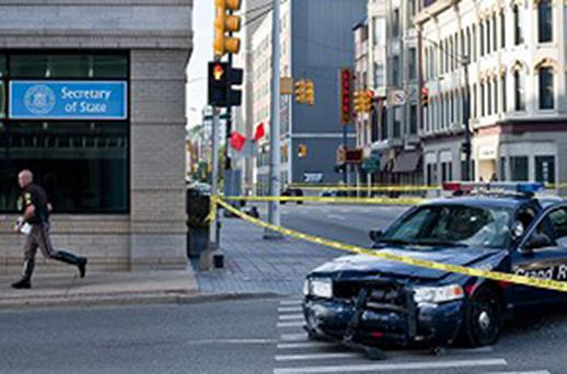 A police car that was both hit and fired upon during a high-speed car chase through Grand Rapids, Michigan. Photo: AP