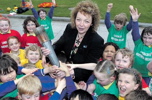Northern Ireland's Culture Minister Caral Ni Chuilin welcomes news of the visit of the Olympic Torch with children from Belfast primary schools