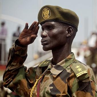 A Southern Sudanese soldiers stands at attention during the national anthem during an independence rehearsal procession in Juba (AP)