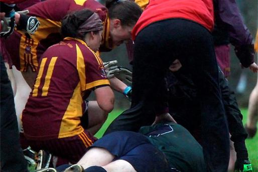 Referee Simon Brady is knocked unconscious after a spectator punches him at a ladies football match