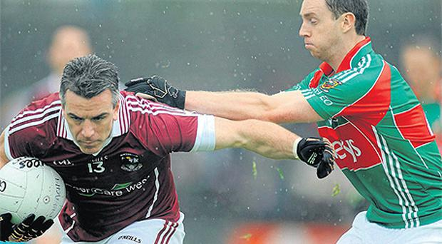 Galway's Padraic Joyce and Keith Higgins of Mayo clash during last month's Connacht SFC semi-final at Castlebar