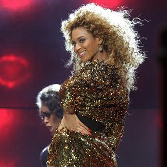 File photo dated 26/06/2011 of Beyonce performing on the Pyramid Stage at the Glastonbury Music Festival, wowing thousands at Glastonbury a week ago, has now seen her new album shoot straight to number one, according to the Official Charts Company. PRESS ASSOCIATION Photo. Issue date: Monday July 4, 2011. The album, called 4, was released in the UK on June 27, a day after her headline performance at the festival. See PA story SHOWBIZ Charts. Photo credit should read: Yui Mok/PA Wire