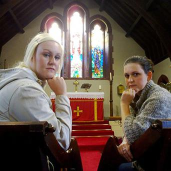 Stephanie Rowe and Emily Morton stage a sit-in protest at All Saints Church in Maerdy, Rhondda