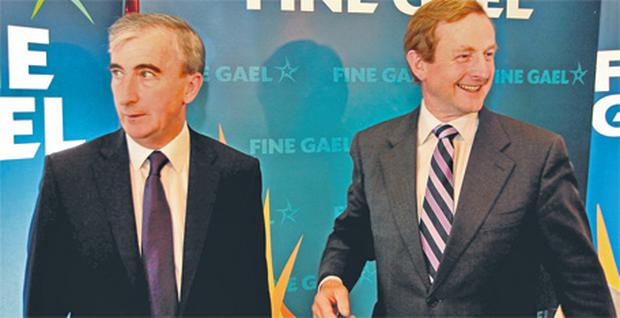 Enda Kenny and Gay Mitchell after the results of the race for the Fine Gael nomination were announced last night
