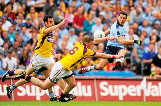 Dublin's Bernard Brogan in action against Wexford's Graeme Molloy. Photo: Sportsfile