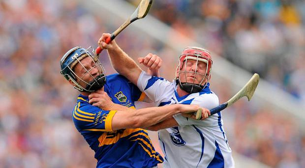 Waterford's John Mullane grapples with Tipperary's Paddy Stapleton during yesterday's Munster SHC final at Pairc Ui Chaoimh. Photo: Sportsfile