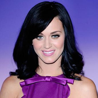 Katy Perry has postponed concerts in the US because she's suffering from food poisoning
