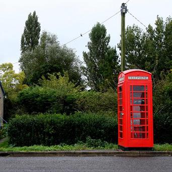 Villagers angered by the loss of their historic local pub have turned a redundant red telephone box into an alehouse for a night