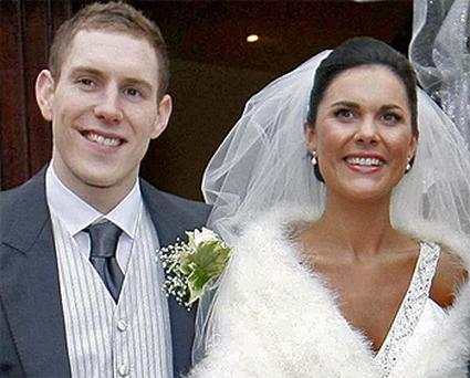 Michaela pictured on her wedding day with husband John McAreavey