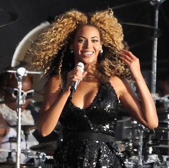 Beyonce is top of the album charts for the second week running
