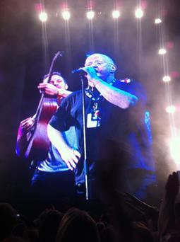 Christy Moore with Coldplay's Chris Martin on stage at Oxegen