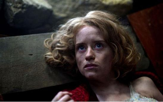 Claire Foy as Helen , caught in a Nazi bomb attack during the Blitz, in The Night Watch on BBC Two
