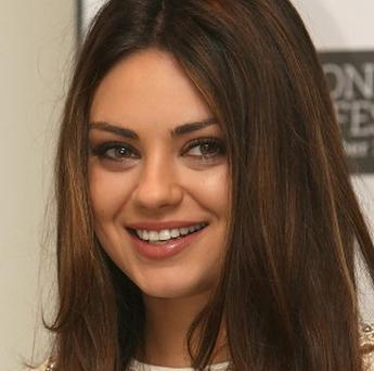 Friends With Benefits actress Mila Kunis said she would accept a date with the US Marine who asked her on YouTube