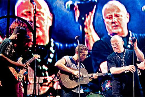 Christy Moore joined Coldplay lead singer Chris Martin on stage at Oxegen on Sunday night. Photo: Peter Neill