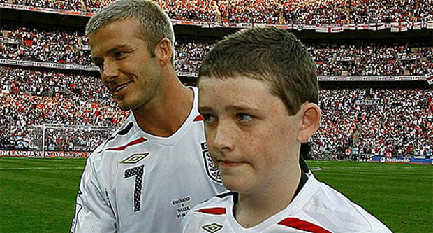 Robert Sebbage as England team mascot alongside David Beckhan at Wembley. Photo: Reuters