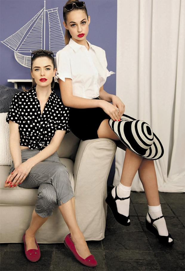 Above: Nikki (in chair) wears black-and-white shirt, €24; check capri pants, €30, sunglasses, €20, and pink suede loafers, €60, all M&S Thalia (on arm of chair) wears white cotton puff-sleeved shirt, ¤16; black linen shorts, ¤40; striped hat, €24; sunglasses,€20; white socks, €4 (pack of three), and black suede wedge sandals, €38, all M&S