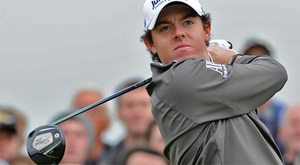 Rory McIlroy tees off from the fourth during round one of the Open. Photo: PA
