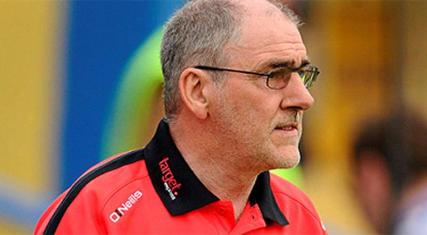 Tyrone manager Mickey Harte is faced with a difficult task in persuading Owen Mulligan to return to the fold. Photo: Sportsfile