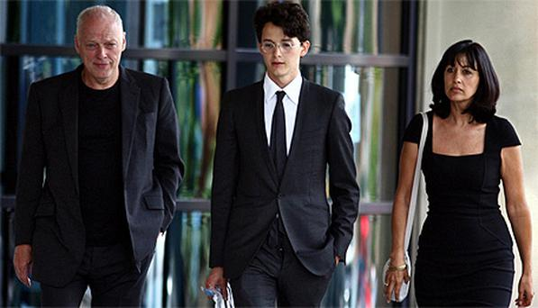 Charlie Gilmour leaves with his adopted father David Gilmour (left) and mother Polly Samson after apearing at Kingston-Upon-Thames Crown Court. Photo: PA