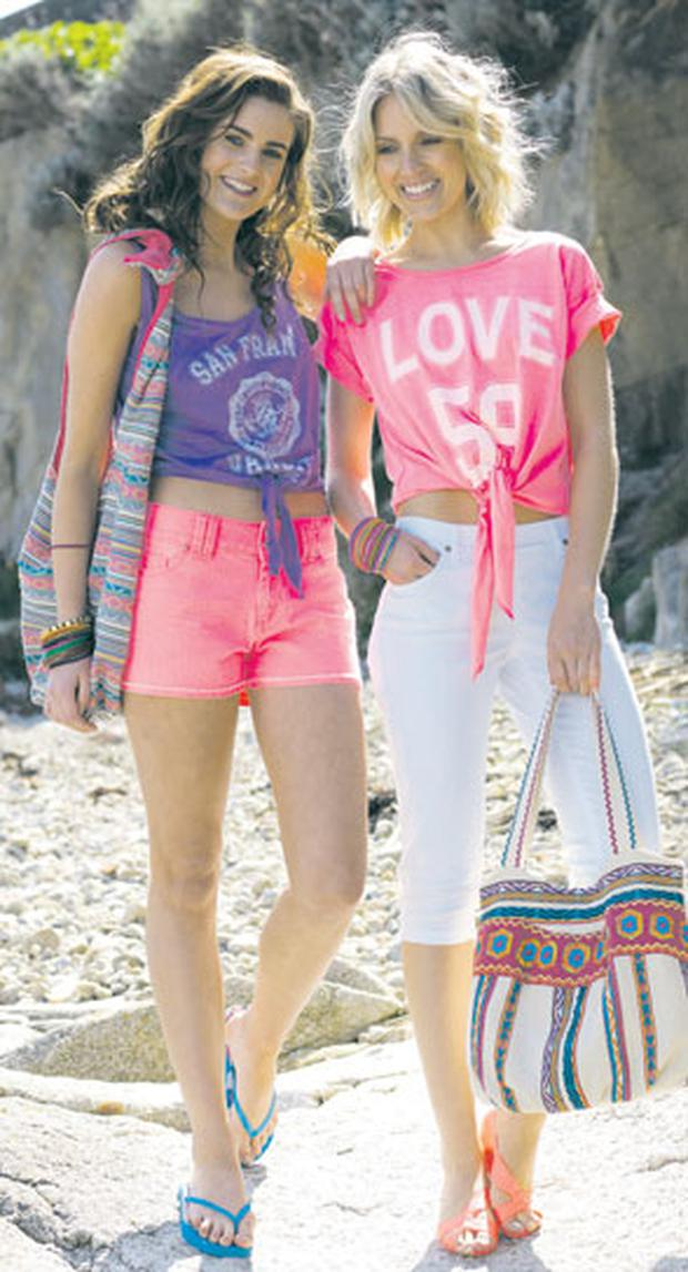 Left, shorts, €15, and top, €8; right, cropped coloured jeggings, €11, and crop neon tee, €10, all Dunnes