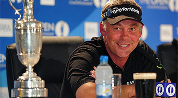 Darren Clarke at the winner's press conference with a pint of the black stuff and the Claret Jug. Photo: Getty Images