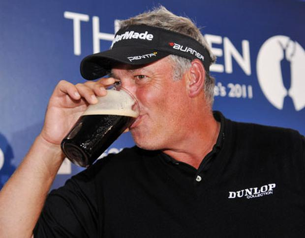 OPEN CHAMPION: Darren Clarke poses with a pint of Guinness during the press conference after his victory in the 2011 British Openat Royal St George's. Photo: Getty Images
