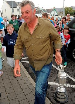 Newly crowned British Open champion Darren Clarke arrives with the famous Claret Jug trophy at his local bar in the Bayview Hotel, Portballintrae, Co Antrim